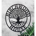 """""""Tree of Life"""" Circular Iron House Name Sign on a Rustic Finish Wall"""