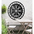 """Vegvisir"" Viking Compass Wall Art in the Garden Above a Wooden Table & Chair Set"
