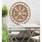 """Vegvisir"" Viking Compass Wall Art in the Garden Above a Wooden Table & Chair Set"