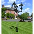Black Victorian Triple headed lamp post outside house