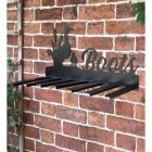 Wall Mounted Duck Iron Boot Holder Mounted on a Brick Wall