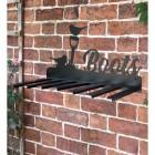 Wall Mounted Robin Iron Boot Holder Mounted on a Brick Wall