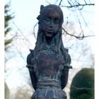 Close-up of the Antique Bronze Alice Sculpture