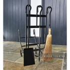 View of the Back of the Wrought Iron Log Holder With Tools