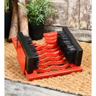 Bright red cast iron three in one boot jack, brush & scraper