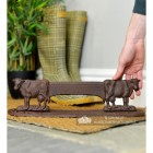 """Cast Iron """"Digby's Dairy"""" Boot Scraper to Scale"""