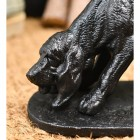 Detailed image of dog face on cast iron boot scraper