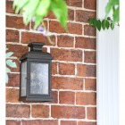 """""""York"""" Aged Copper Wall Lantern Next to the Front Door"""