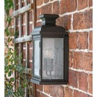 """View fo the side of the """"York"""" Aged Copper Wall Lantern Mounted on a Brick Wall"""
