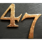 rustic copper numbers on slate plaque