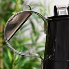Close-up of the Bright Chrome Handle on the Watering Can