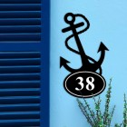 Anchor Iron House Number Sign on a Blue Wall