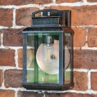 Antique Bronze Hanging Wall Light on a Brick Wall