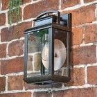 Hanging Wall Light With Reflector Plate in Antique Bronze