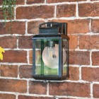 Antique Bronze Hanging Wall Light With Reflector Plate in Situ on a Brick Wall