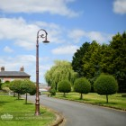 Antique Copper Finish Ornate Victorian Cast Iron Lamp Post Installed Along Driveway