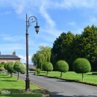 Antique Copper Garden Lamp Post Installed On Driveway