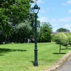 Antique Green Opulent Cast Iron Lamp Post In Garden Setting