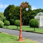 Antique Red Ornate Cast Iron Globe Lamp Post In Garden