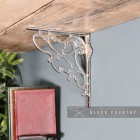 """""""Art Nouveau"""" Polished Aluminium Shelf Bracket Holding up a Wooden Shelf"""