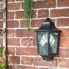 """Avebury Manor"" Traditional Half Lantern Wall Light on a Brick Wall"