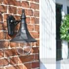 Black doorway lantern on brick wall
