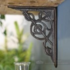 Compact floral bracket finished in cast iron