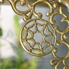 Close up of cast brass scroll detail