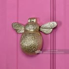 Honey bee door knocker on bright pink door