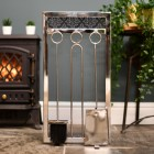 Sleek modern companion set in living room by log burner