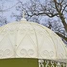 Solid roof with ornate scrolling pattern on garden pavilion