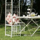 Iron chair built into gazebo framework