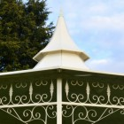 Slopping roof with ornate finial
