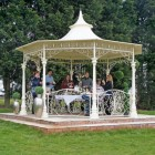 Cream garden gazebo on patio octagonal shape