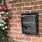 Minimalist black wall mounted letter box