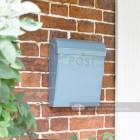 Light  pastel blue post box by front door