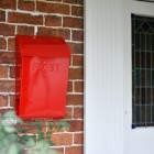 Modern post box mounted outside front door