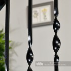 Detailed image of satin black wrought iron spindles