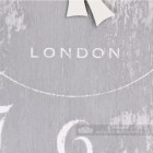 """Close up of printed text """"London"""" on wall clock"""