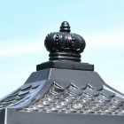 Regal crown finial on black post box