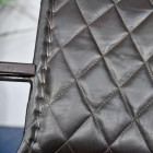 Close up of leather chair with visible stitching