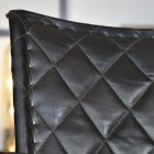 Close up of chair backrest with diamond stitching