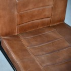 Close up of visible stitching in leather chair