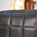 Close up of stitching and square detailing