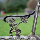 Black and Bronze Rose Design Bench Arm