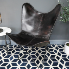 """Black """"Butterfly"""" Leather Chair in Situ"""