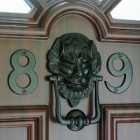 Black Lion Door Knocker in Situ on a Brown Door