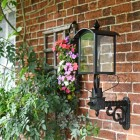 Black Four Sided Lantern On Scrolled Wall Bracket