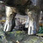 Close-up of the Feet on the Black & Gold Piglet Garden Sculpture