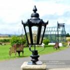 Black Hexagonal Pillar Light and Lantern Set in Situ on a Brick Pillar